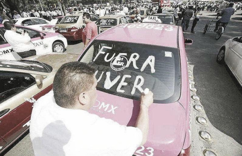 ¿Es real esta fotografía tomada durante una protesta contra Uber en México?...  ¡Responde nuestro quiz de noticias!