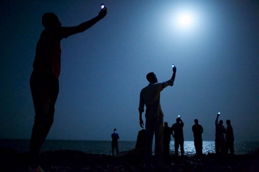 Fotografía de John Stanmeyer, ganador del premio World Press Photo 2014 en la categoría de Foto del Año.